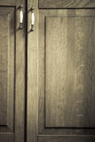 Furniture part. Closeup of wooden kitchen cabinet. Furniture part. Retro style. Closeup of vintage wooden kitchen cabinet or cupboard with metal handles as Royalty Free Stock Photos