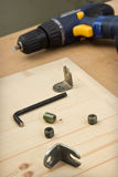 Furniture parts and electric screwdriver on the table Stock Photo