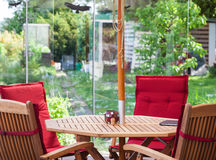 Furniture on patio in garden Royalty Free Stock Images