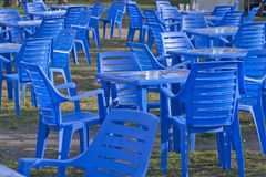 Furniture, Plastic Chairs and Tables. Patio,  food. Plastic Dark blue Chairs and Tables Stock Photo