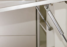 Furniture rack, gas lift for the furniture fronts of kitchen uni. Ts closeup Stock Photos