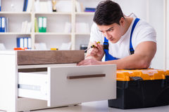 The furniture repair and assembly concept. Furniture repair and assembly concept Royalty Free Stock Photography