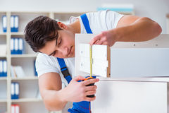 The furniture repair and assembly concept. Furniture repair and assembly concept Stock Photography