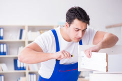 The furniture repair and assembly concept. Furniture repair and assembly concept Stock Image