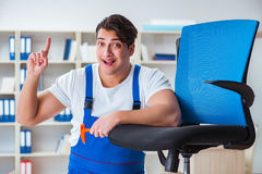 The furniture repair and assembly concept. Furniture repair and assembly concept Royalty Free Stock Photo