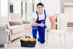 The furniture repairman at home service Royalty Free Stock Image
