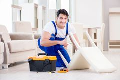 The furniture repairman working in store Stock Photos