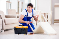 The furniture repairman working in store Royalty Free Stock Image