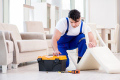 The furniture repairman working in store Royalty Free Stock Photos