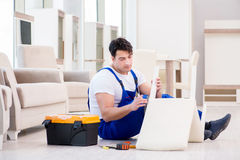 The furniture repairman working in store Stock Photo