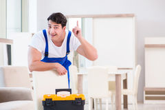 The furniture repairman working in store Royalty Free Stock Photo