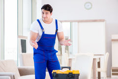 The furniture repairman working in store Stock Photography