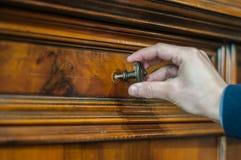 Furniture restauration. Artisan restoring an old wood furniture Stock Photo
