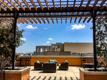 urban roof deck with furniture and view of the city royalty free stock image
