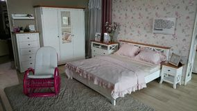 Furniture showroom: modern bedroom with pink rocking chair Royalty Free Stock Photo
