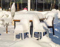 Furniture in Snowy summer café in the center of the old town of Pomorie in Bulgaria, winter Stock Photo