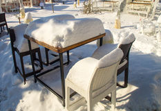 Furniture in Snowy summer café in the center of the old town of Pomorie in Bulgaria, winter Stock Image