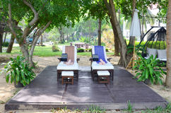 Furniture for spa and thai massage in garden Royalty Free Stock Photos