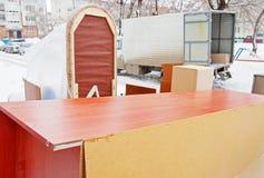 Furniture stands outdoor near the van Stock Image