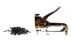 Furniture stapler and rusty screws Stock Photo