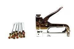 Furniture stapler and screws Stock Photo