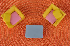 Furniture toy on orange grass intertexture Royalty Free Stock Photo