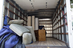 Furniture in the truck. Moving to a new house Royalty Free Stock Photo