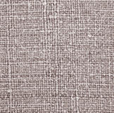 Furniture upholstery brown fabric as background. Abstract textur Royalty Free Stock Image