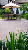 Furniture on wood deck outdoors Royalty Free Stock Photography