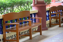 Furniture on wood deck outdoors Royalty Free Stock Photos