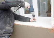 Furo de perfuração do contratante de construção para o suporte do plástico da isolação fotos de stock