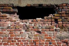 Furo do tijolo na parede Fotos de Stock Royalty Free