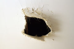 Furo na parede Imagem de Stock