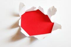 Furo vermelho com copyspace fotos de stock