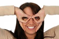 Furos bonitos Peeping da mulher Fotografia de Stock