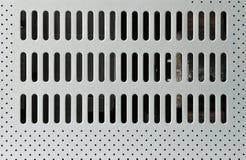Furos mais frescos na placa metálica Fotografia de Stock
