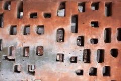Furos ocos do tijolo na parede Imagens de Stock Royalty Free