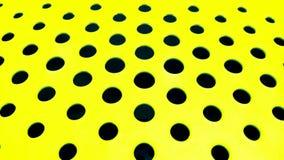 Furos redondos pretos em uma superfície amarela plana para ir adiante como o fundo imagens de stock royalty free