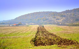 Furrow in fall field. Autumn tractor plowing field sight in East Balkan mountain foggy weather conditions.Picture taken on November 7th,2014 ,Bulgaria Royalty Free Stock Photo