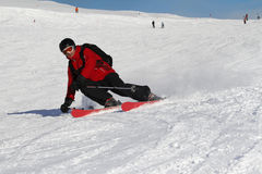 Furrowing skier. Furrowing turns with extreme sloping positions by a skier Royalty Free Stock Images