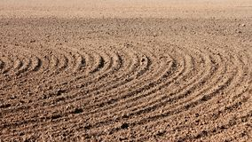 Furrows on field Stock Photo