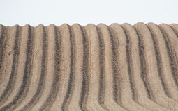 Furrows in ploughed field Royalty Free Stock Photo