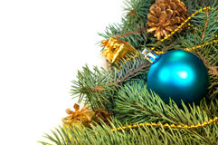 Furry Christmas tree branches with cones, gifts Royalty Free Stock Photography