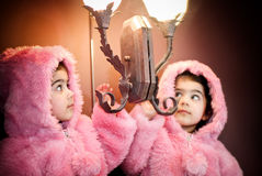 Furry coat and reflection. A close-up portrait of a two year old in pin furry jacket Royalty Free Stock Photos