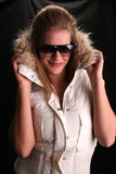 Furry fun. Model wearing a fake fur trimmed hooded jacket Royalty Free Stock Photography