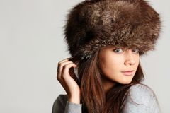 Furry hat. Woman in a furry hat in studio Stock Photo