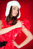 Furry hat and red feather on xmas girl Stock Photography