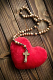 Furry heart with rosary beads Royalty Free Stock Photos