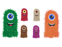 Furry monster family in different colors Royalty Free Stock Image