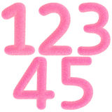 Furry pink numbers Royalty Free Stock Images